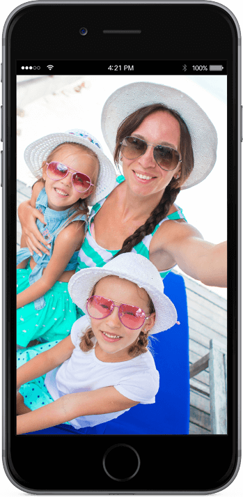 Image of a mom and two children on a cellphone screen