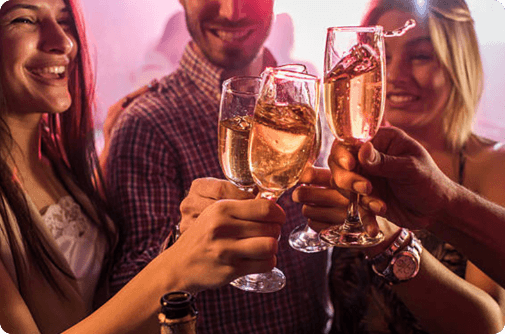 people clinking champagne glasses together in Las Vegas