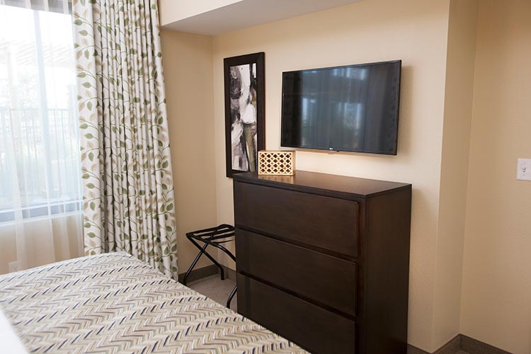 guest suite bedroom with flat screen tv, The Berkley, Las Vegas
