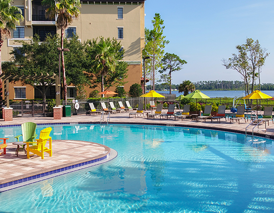 outdoor heated U-shaped swimming pool with colorful pool chairs, The Berkley, Orlando