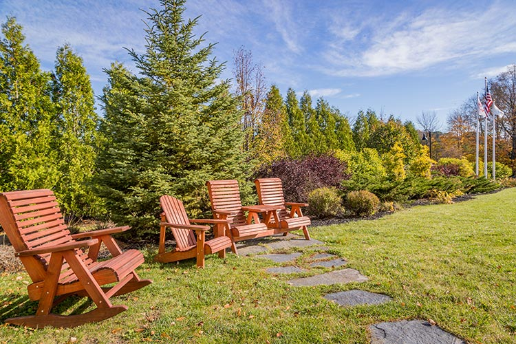 outdoor sitting area with brown Adirondack chairs, Berkshire Mountain Lodge