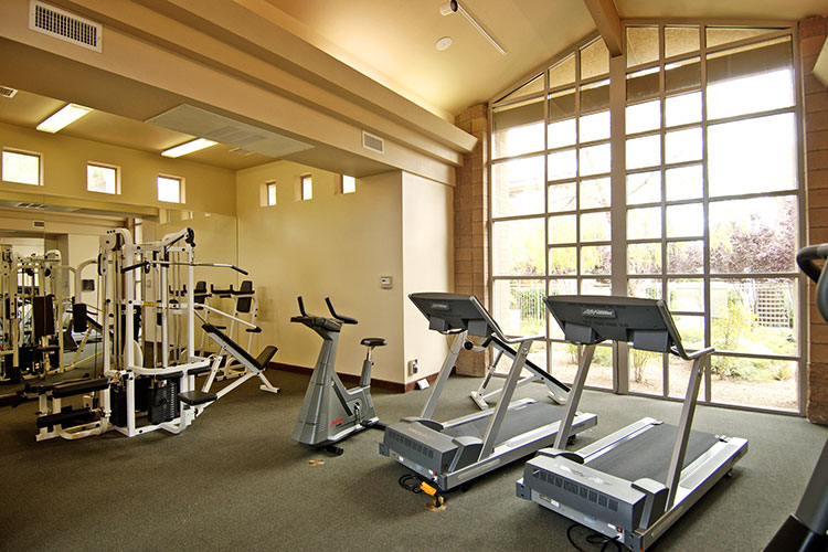 fitness center with cardio equipment behind lobby, The Cliffs at Peace Canyon