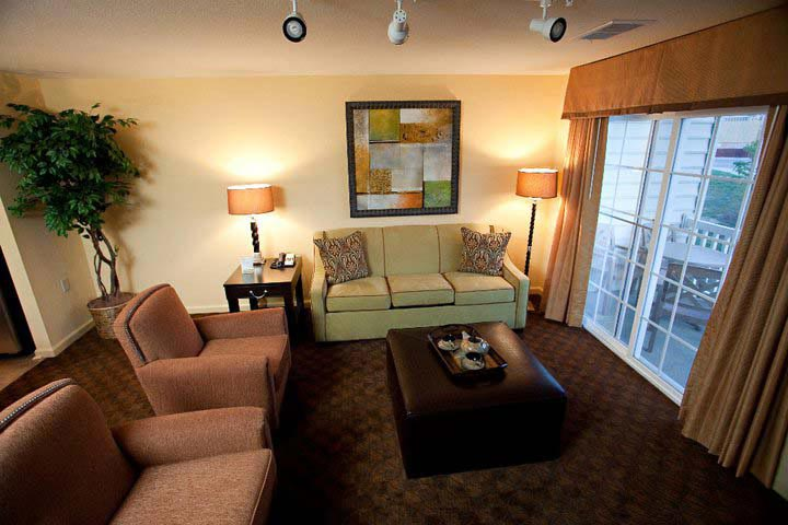 Guest suite living room areas with window showing furnished balcony, The Colonies at Williamsburg