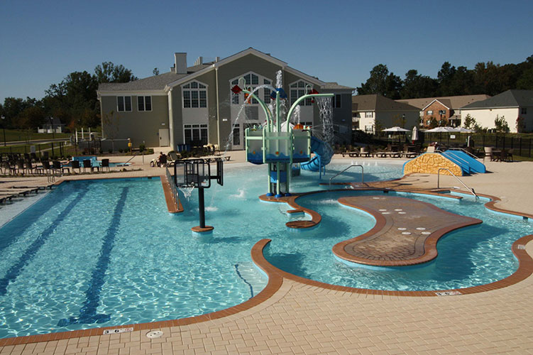 outdoor swimming pool with numerous water features, The Colonies at Williamsburg