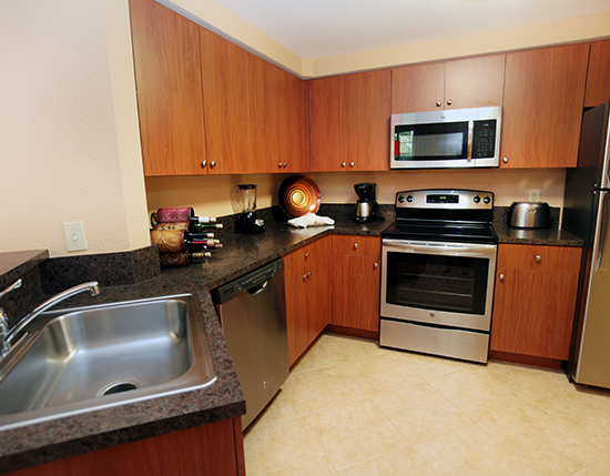 A Suite fully equipped kitchen with stove, Mizner Place at Weston Town Center