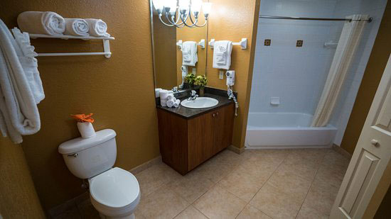 guest suite bathroom with tub shower, Mizner Place at Weston Town Center