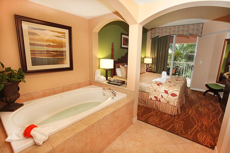 A Suite bedroom with jetted tub, Mizner Place at Weston Town Center.