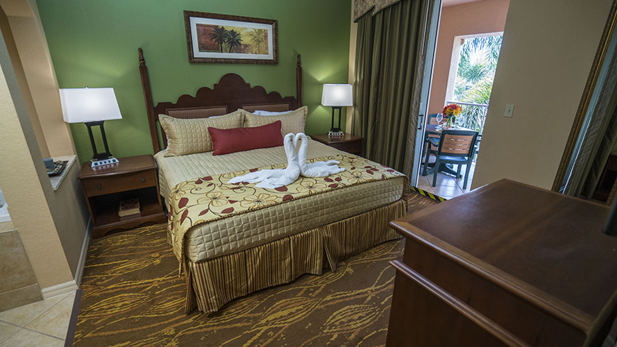A Suite guest bedroom with sliding door access to balcony, Mizner Place at Weston Town Center