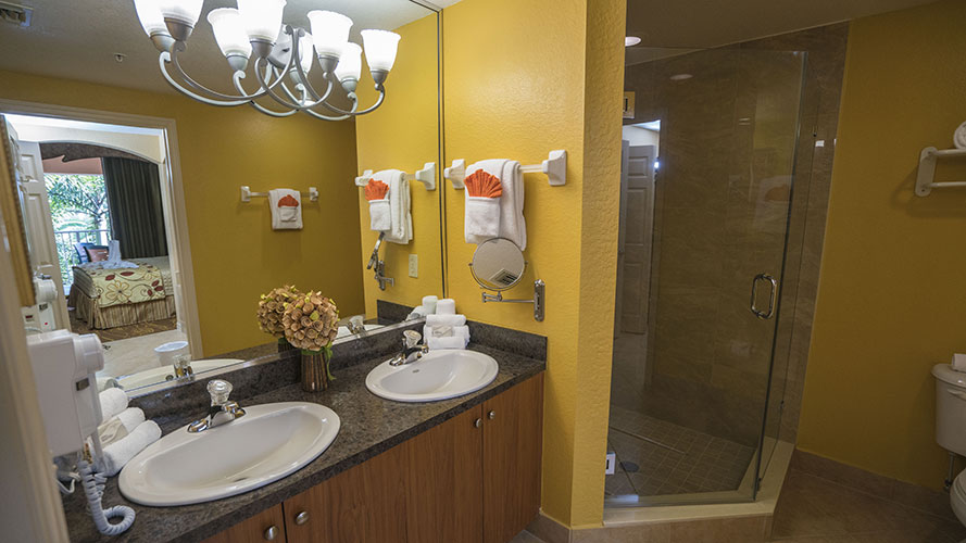 A Suite bathroom with walk in shower, Mizner Place at Weston Town Center