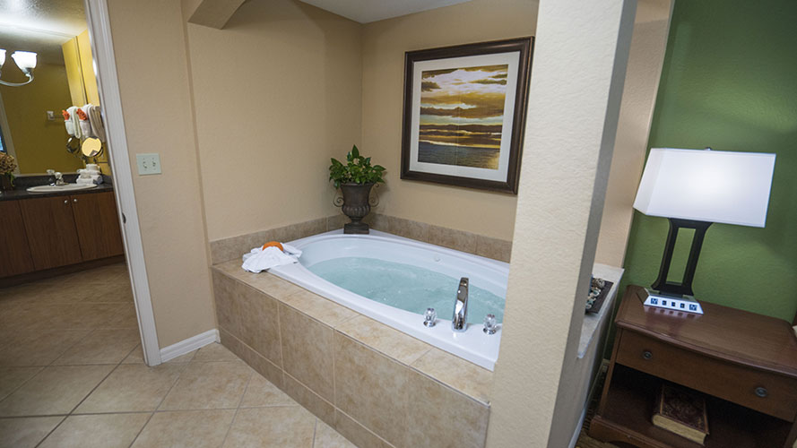 A Suite master bedroom with separate jetted tub, Mizner Place at Weston Town Center