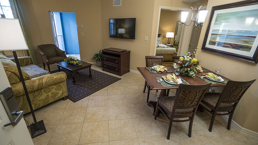 B Suite guest living room and dining room, Mizner Place at Weston Town Center