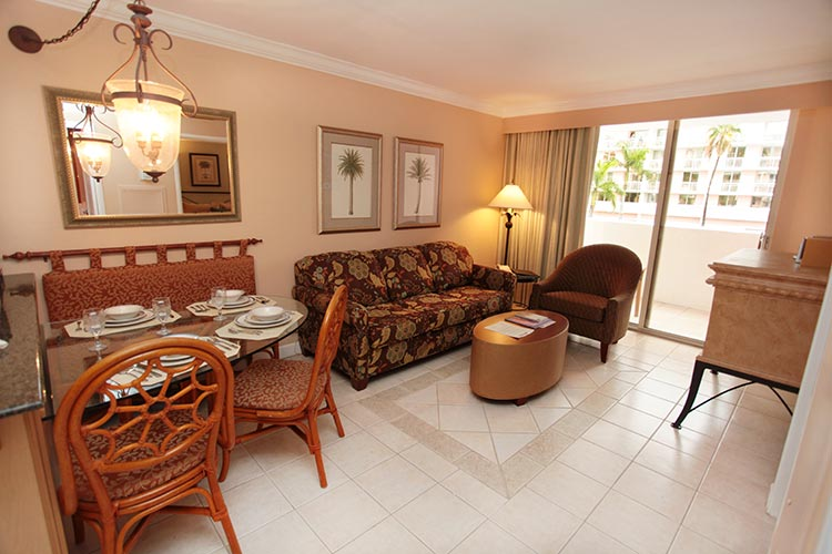 guest suite living room area with sliding door access to private balcony, Palm Beach Shores Resort and Vacation Villas