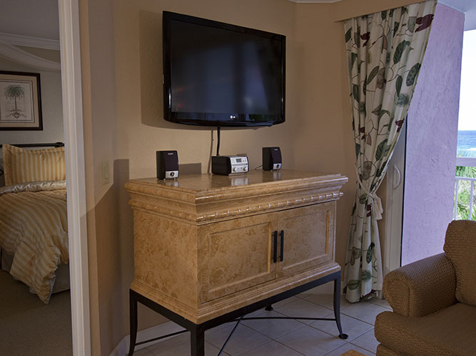 living room entertainment center with flat screen tv, Palm Beach Shores Resort and Vacation Villas