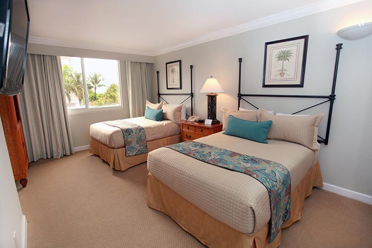 B Suite gust bedroom with two double beds and picture window with pool or garden view, Palm Beach Shores Resort and Vacation Villas