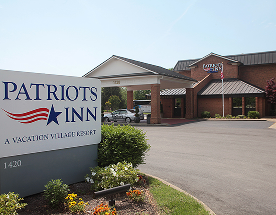 resort front entrance with logo sign, Patriots Inn