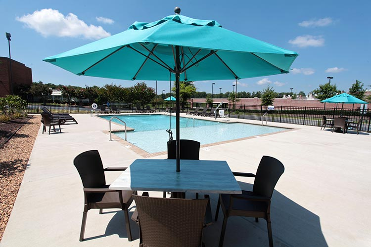 outside pool area with umbrella and chairs, Patriots Inn
