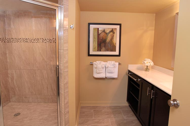 guest suite bathroom with tiled, walk in shower, Patriots Inn
