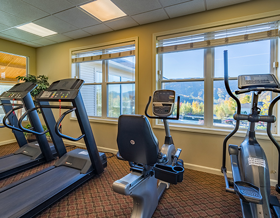 fitness center on second floor of clubhouse with view of mountains, Vacation Village in the Berkshires