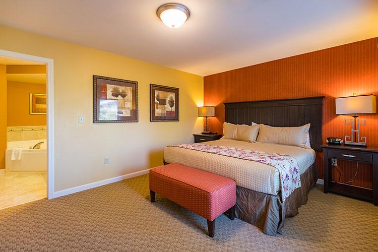guest suite bedroom with open door to master bathroom , Vacation Village in the Berkshires