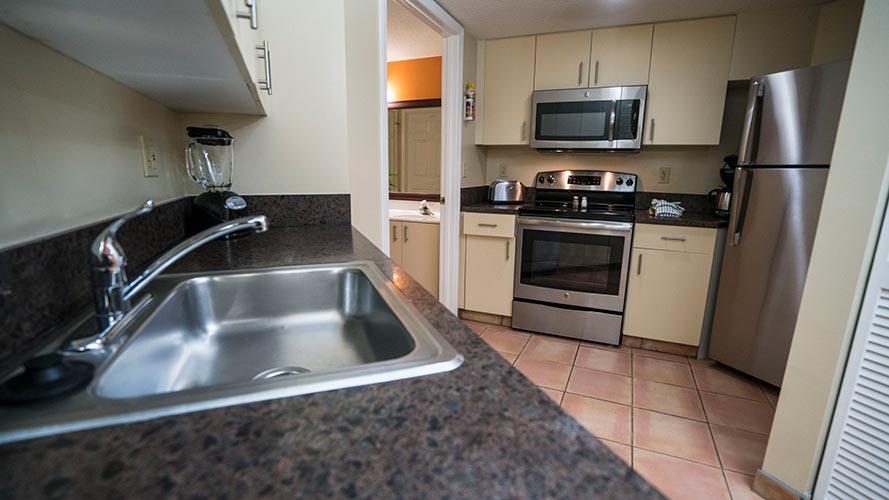 A Suite guest full kitchen, Vacation Village at Bonaventure