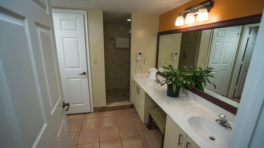 A Suite guest bathroom with walk in shower, Vacation Village at Bonaventure