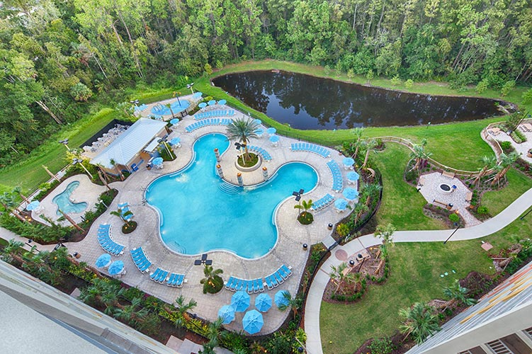 drone shot of Building 21 pool area, Vacation Village at Parkway