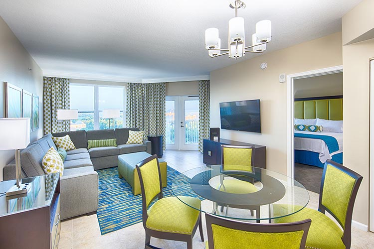 guest living room and dining room area in A Suite, Vacation Village at Parkway