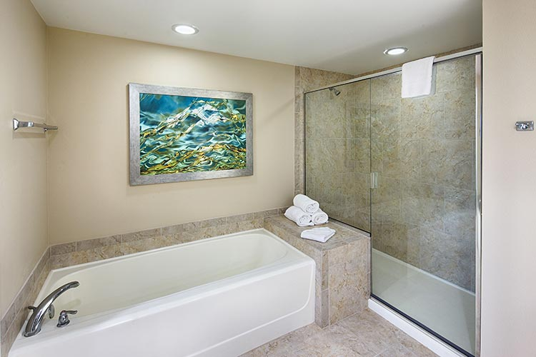 guest master bathroom with separate tub and walk in shower in A Suite of buildings 20 and 21, Vacation Village at Parkway