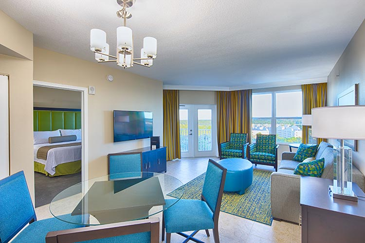 guest living room and dining area in C Suite, Vacation Village at Parkway.
