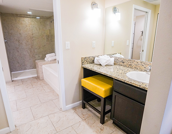 separate vanity area and bath tub with walk-in shower in C Suite, Vacation Village at Parkway