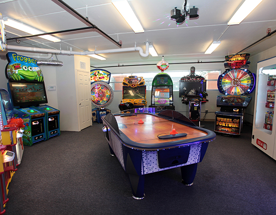 arcade room with large air hockey table in building 20, Vacation Village at Parkway
