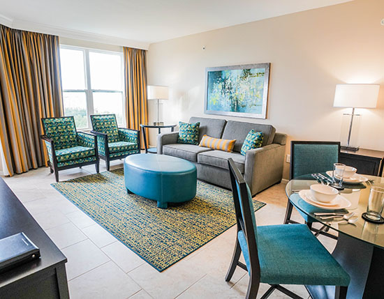 guest living room and dining area in C Suite of buildings 20 and 21, Vacation Village at Parkway