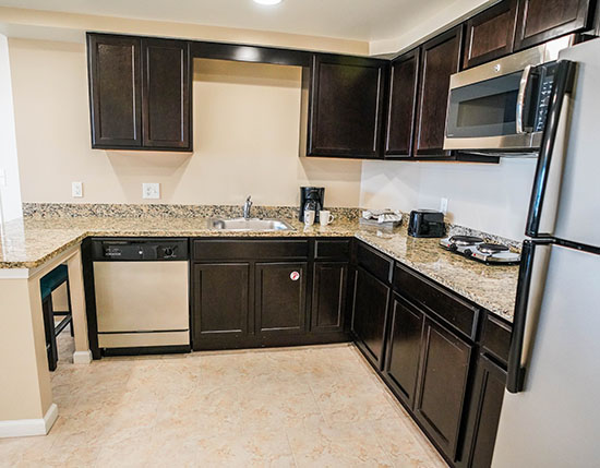 guest partial kitchen with granite countertops and hot place in C Suite, Vacation Village at Parkway.