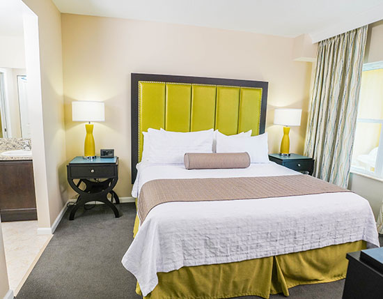 guest master bedroom with master bathroom in C Suite, Vacation Village at Parkway