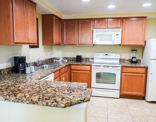 guest full kitchen with stove and oven in A Suite, Vacation Village at Parkway