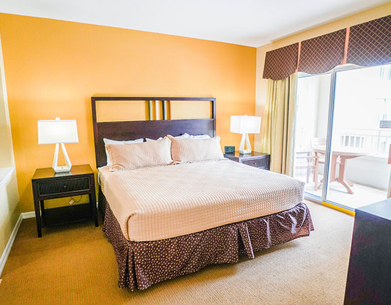 guest bedroom with separate jetted tub and balcony in A Suite, Vacation Village at Parkway