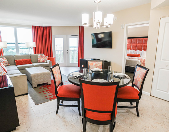 guest living room and dining area in A Suite, Vacation Village at Parkway