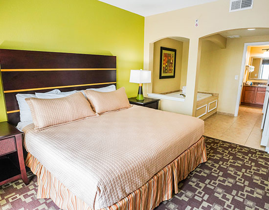 guest suite bedroom with separate jetted tub in C Suite, Vacation Village at Parkway