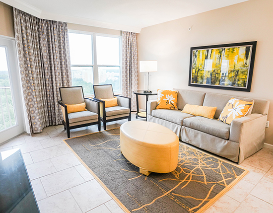 guest living room area in C Suite, Vacation Village at Parkway