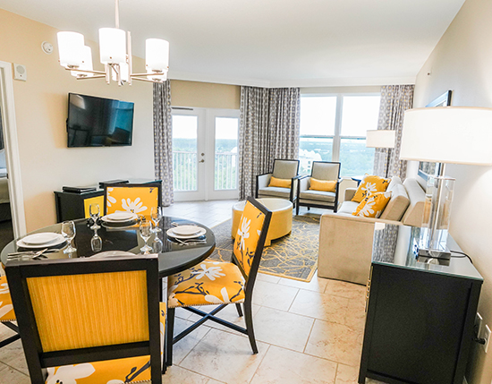guest living room and dining area in C Suite, Vacation Village at Parkway