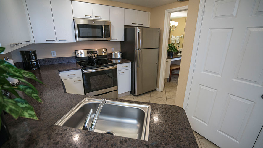 A Suite guest full kitchen, Vacation Village at Weston