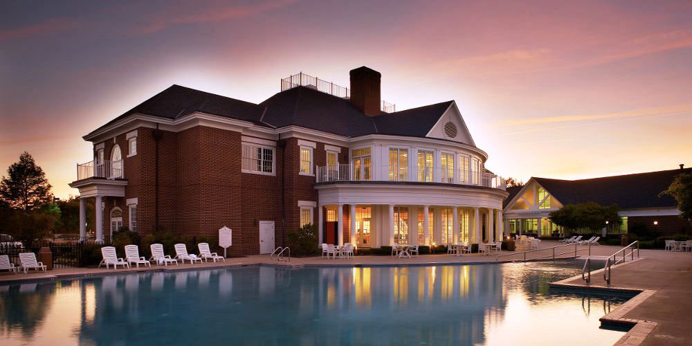 resort clubhouse and outdoor pool area during sunset, Williamsburg Plantation