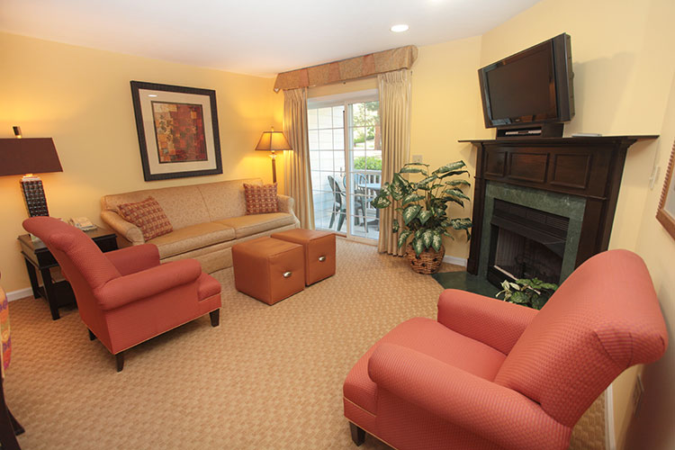 guest suite living room area with sliding door access to private furnished balcony, Williamsburg Plantation
